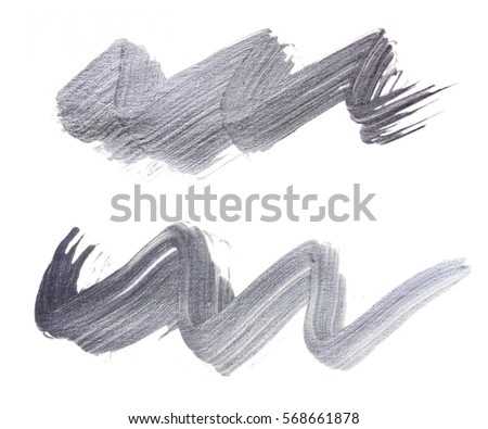 Set of silver brush strokes of acrilic paint as sample of art product isolated on white background