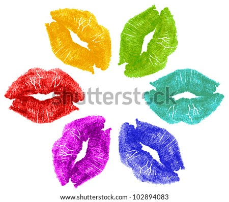Set of six lipstick kisses in red, yellow, green, cyan, blue, purple in flower formation pattern isolated on white background.