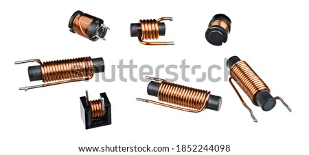 Set of solenoid coils with black ferrite core isolated on white background. Close-up of cylindric inductors with helical copper wire winding. Group of electronic components. Electromagnetic induction. Stok fotoğraf ©