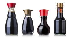Set of soy sauce bottles isolated on white background
