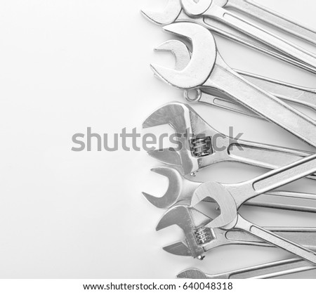 Set of spanners and screw wrenches on white background