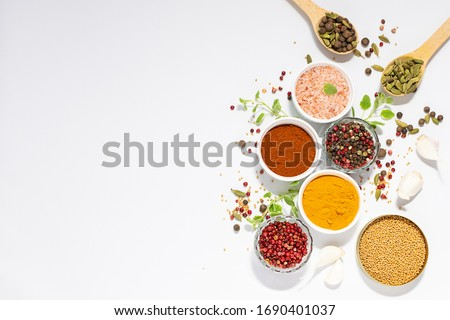 Set of spices and aromatic herbs on white background with copy space for your text. Aromatic spices for healthy lifestyle. Template culinary blog social media.