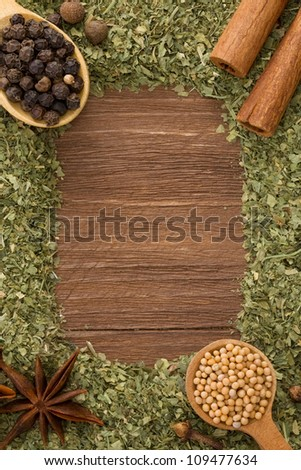 set of spices and spoon on wood background