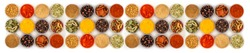Set of spices in jars on a white background. A long banner of a variety of Indian spices, herbs, peppers.