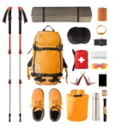 Set of sport equipment and gear for hiking and trekking. Top view of walking sticks, backpack, clothes etc. isolated on white background