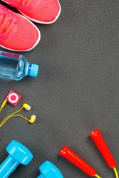 Set of sports accessories for fitness concept with exercise equipment on gray background