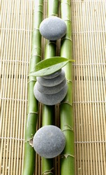 Set of Stacked of stone with bamboo grove and leaf on mat