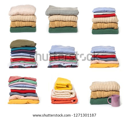 set of Stacks of folded clothes on white background