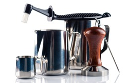 Set of Stainless Steel Milk Pitchers Jugs. Foaming Jug. Latte art for barista. Coffee Accessories. Barista Kit isolated on a white background