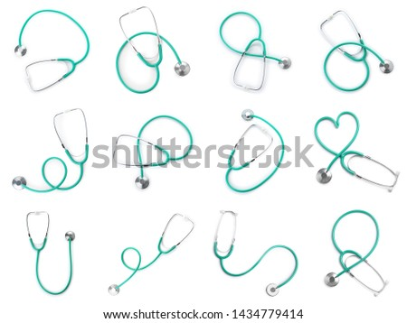 Set of stethoscopes on white background, top view. Medical device