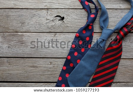 Set of stylish men accessories, men's fashion, different neckties on rustic wood background. The concept of Fathers Day greeting card, copy space for text #1059277193