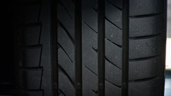 Set of summer car tires isolated,Tire stack background,Car tyre protector close up,Black rubber tire,New car tires,Close up tyre profile,Close up tyre profile car tires,Surface rubber car.