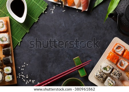 Shutterstock Set of sushi and maki roll and green tea over stone table. Top view with copy space