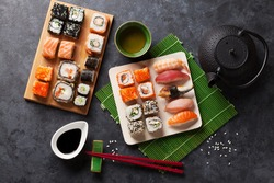 Set of sushi, maki and green tea on stone table. Top view