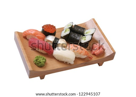 set of sushi with the different types of fish,shrimp,caviar and herring on wooden plate
