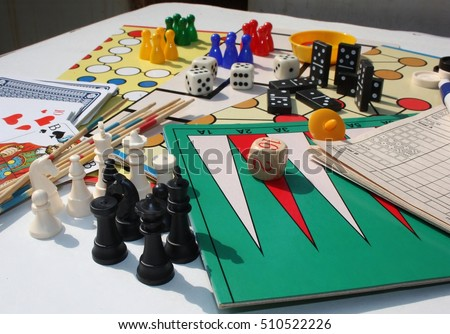 Set of table games with white and black chess pieces in the foreground  Photo stock ©