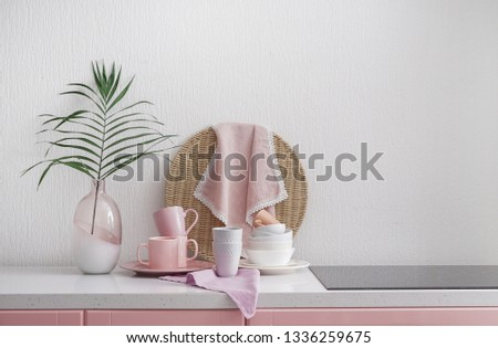 Set of tableware and modern stove in kitchen #1336259675