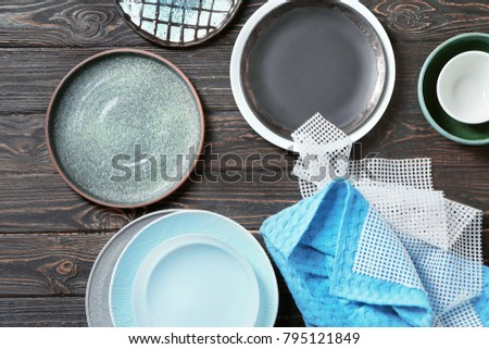 Set of tableware on wooden background #795121849