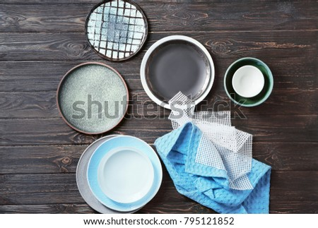 Set of tableware on wooden background #795121852