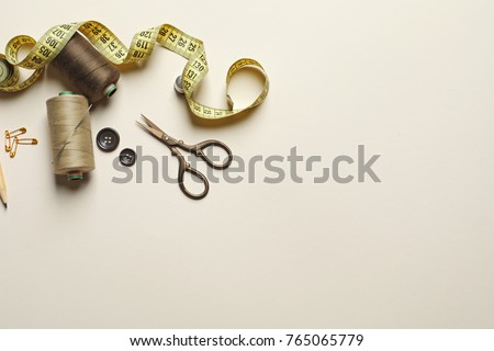 Set of tailoring tools and accessories on table, top view Stockfoto ©