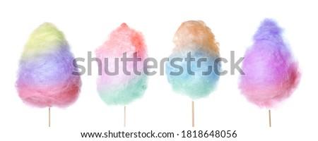 Set of tasty cotton candies on white background
