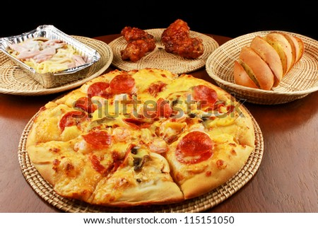 Set of tasty pizza on a wooden table