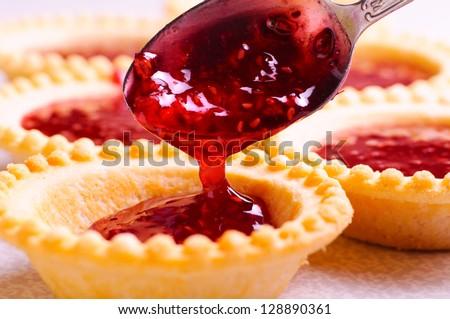 set of tasty tartlets with raspberry jam