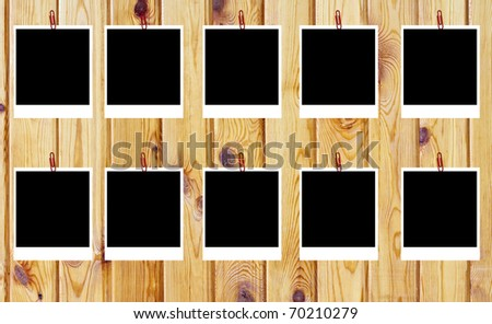 set of ten old blank instant photo frames lying on a wood surface