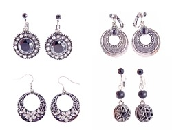 set of the silver earrings on white