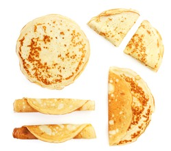 Set of thin pancakes on a white background, isolated. Top view