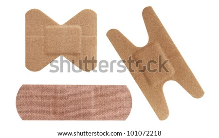 Set of three bandaids or bandages in various shapes over white.