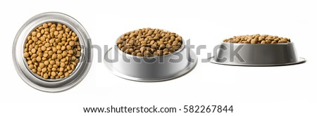 Photo of  Set of three dishes dry pet food in a metal bowl isolated on white background. Top, half and front view