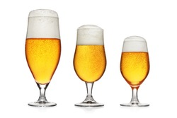 Set of three full glasses of light yellow beer isolated on white background.