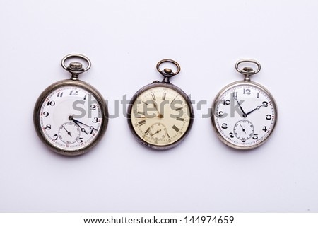 set of three old pocket watches, isolated on white