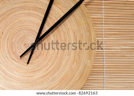 set of three rolled bamboo place mat on white background