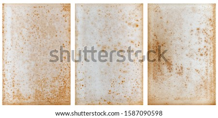Set of three vintage book pages that have similar splotches and speckles from aging.