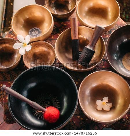 Set of tibetan singing bowls for yoga, spa salon, meditation, sound massage and healing, spiritual practices. Square image