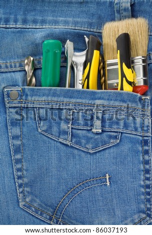 set of tools and instruments in jeans pocket background