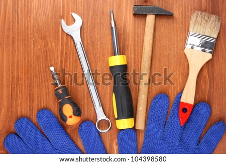 Set of tools and instruments on wooden background #104398580