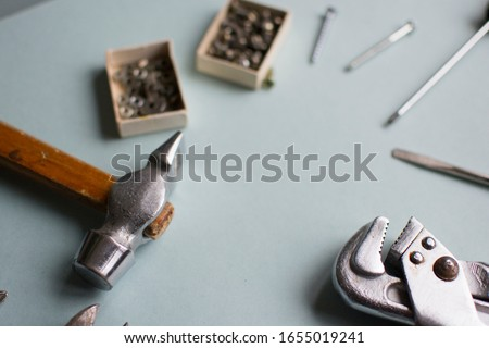 Set of tools. Background with place for male text. Construction tools on a blue background. For congratulations on February 23.