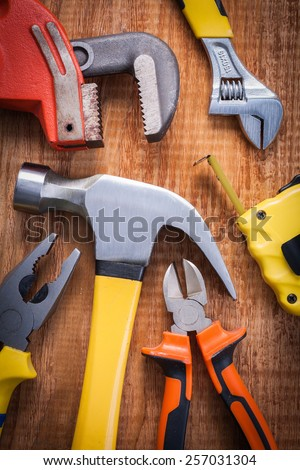 set of tools hammer pliers adjustable wrench and other