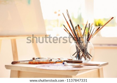 Set of tools on table in artist's workshop