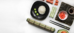 Set of traditional japanese food on a white background.Ingredients for the preparation of rolls and sushi.Asian Food wallpaper.Composition with asian food - rice for sushi, ginger, sauces and chopstic