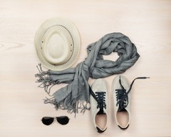 Set of travel items including  shoes, scarf,  sunglasses and straw hat. Planning of  overhead of essentials for vacation and travelling on holiday.
