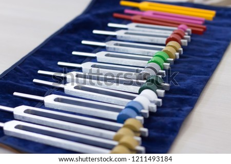 Set of tuning forks for acoustic session on a light background #1211493184