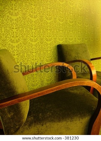 set of two cozy green armchairs in remarkably green room