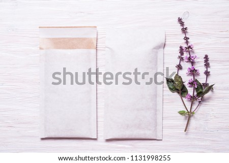Set of two Foam padded envelopes on wooden background #1131998255
