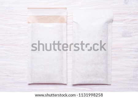 Set of two Foam padded envelopes on wooden background #1131998258
