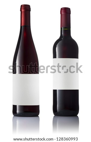 Set of two green bottles with labels of red wine isolated on white background.