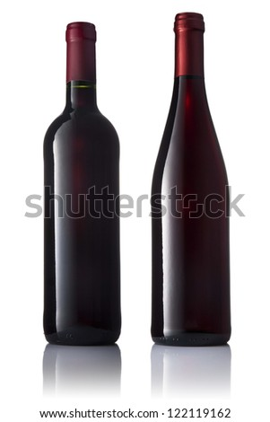 Set of two green bottles with red wine on a white isolated background.